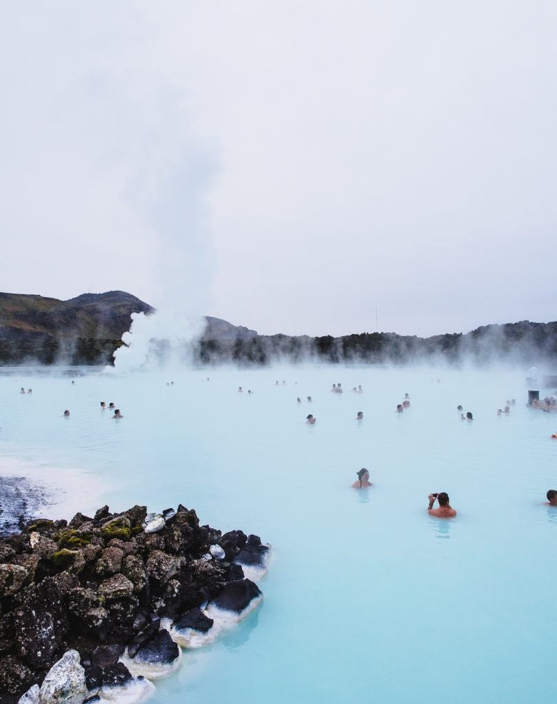 a family swimming in the Blue Lagoon in Iceland