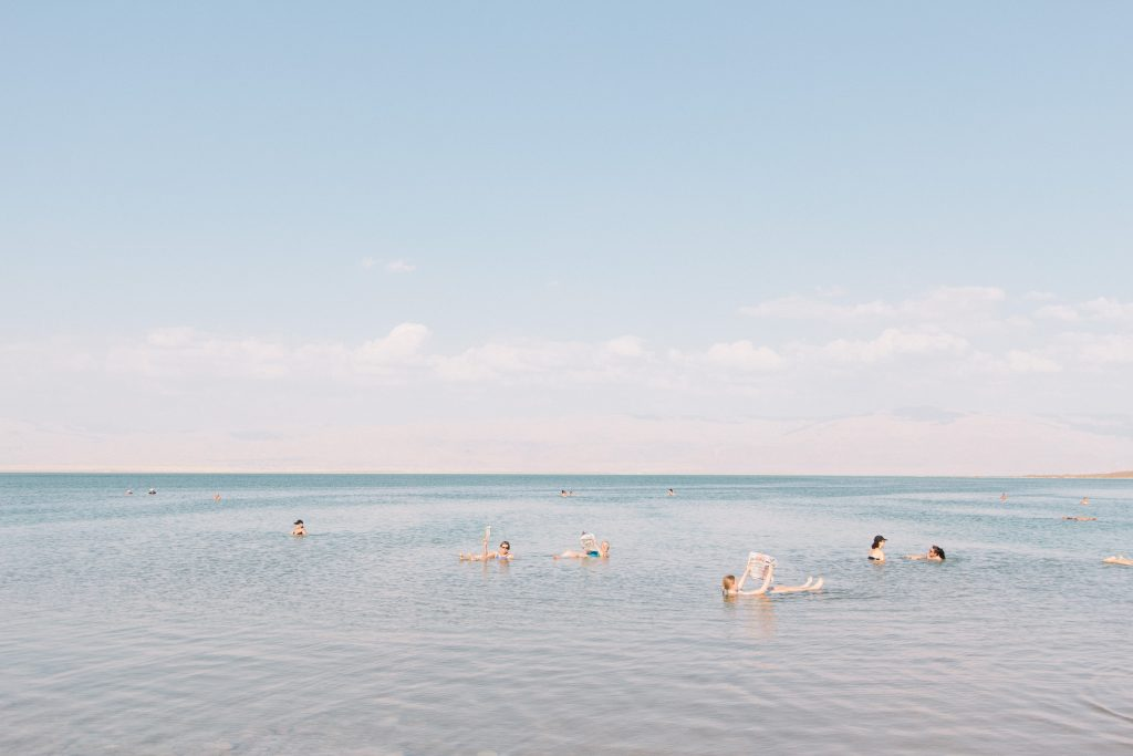 family swimming in the Dead Sea in Israel or Jordan