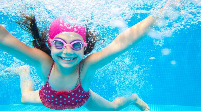 smiling girl in swimming pool