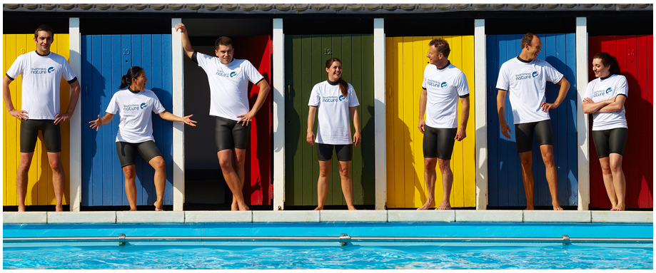 Swimming instructors standing in a line at Tooting Bec lido